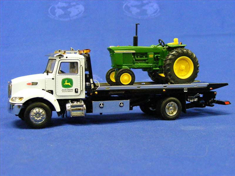 Jerrdan truck decaled with John Deere sales decals and tractor