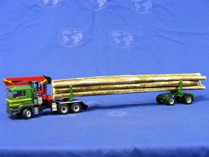 doll-log-truck-on-man-tgs-3-axle-tractor-conrad-CON71179