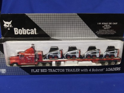 Picture of Bobcat flatbed trailer with 4 Bobcat 753 ss green logo