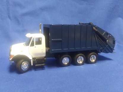 Picture of IH 7000 garbage truck  white cab, blue packer