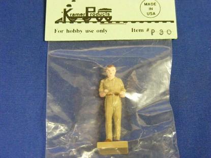 man-standing-in-tan-uniform-kramer-KRMP30