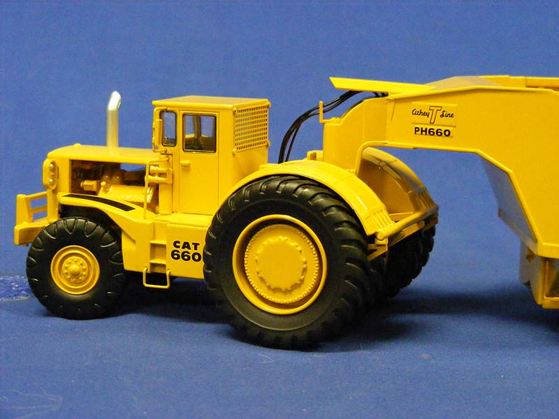cat-660-with-athey-bottom-dump-classic-construction-CCM660