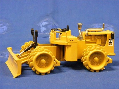 Picture of Caterpillar 825B compactor with blade  new color