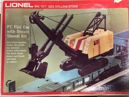 Picture of P&H cable shovel on flatcar yellow