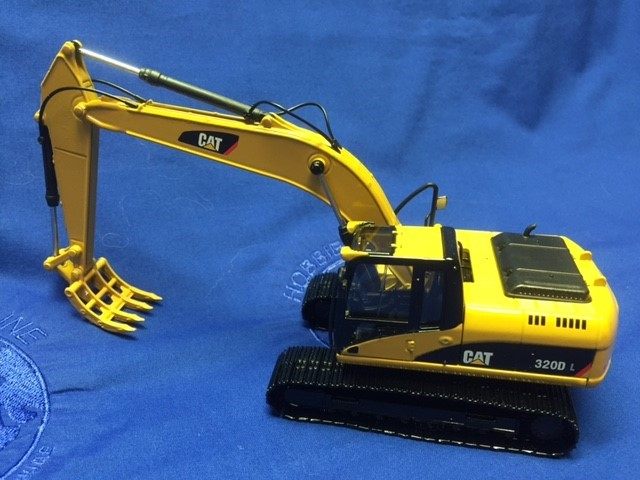 Cat 320D L track excavator with rake