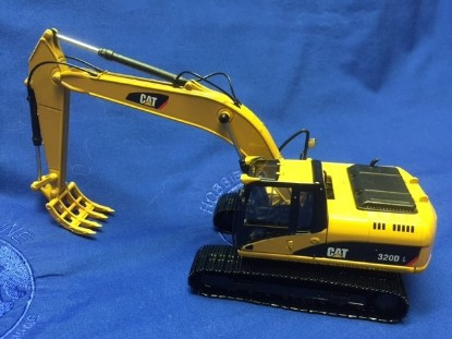 Picture of Cat 320D L track excavator with rake