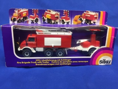 Picture of Unimog fire pumper with light trailer