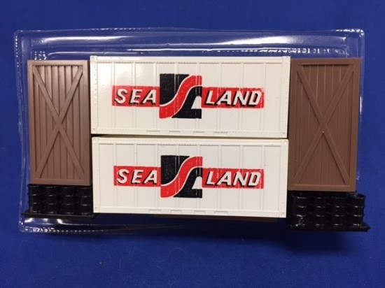 Picture of Cargo- (2) Sealand Containers (3) Crates (2) Oil drum units