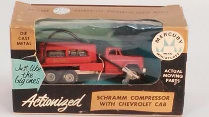 Picture of Schramm compressor on Chevrolet truck orange