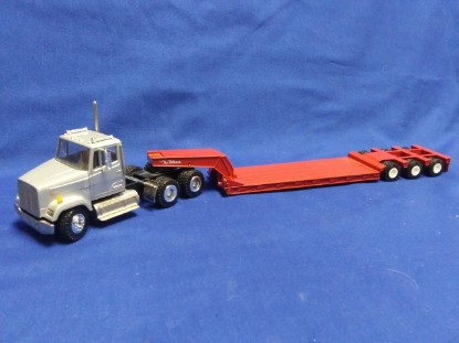 Picture of Freightliner conv. with Talbert lowboy  silver/red
