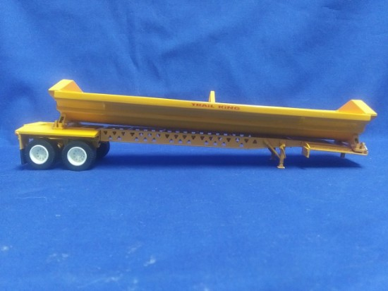 Picture of Trail King side dump trailer - yellow
