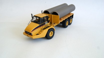 Picture of Cat 740 articulated flatbed with pipes