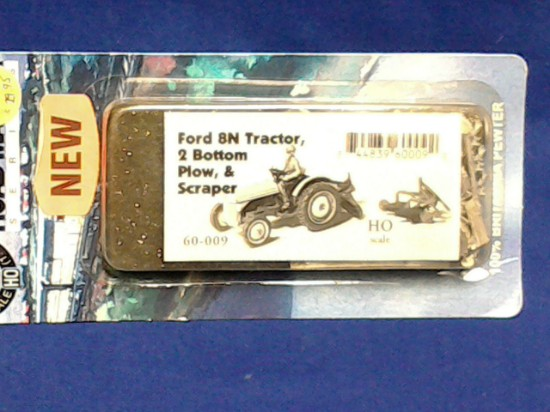 Picture of FORD 8N farm tractor with 2 bottom plow and scraper