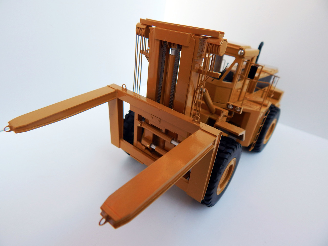 Picture of Cat DV43 wheel loader fork lift - yellow