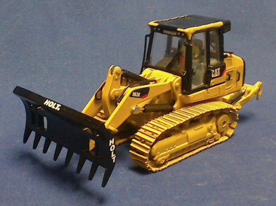 Picture of Caterpillar 963K with Holt  rake attachment