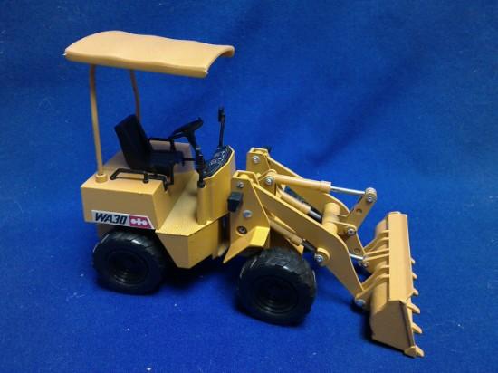 Picture of Komatsu WA30 wheel loader - yellow
