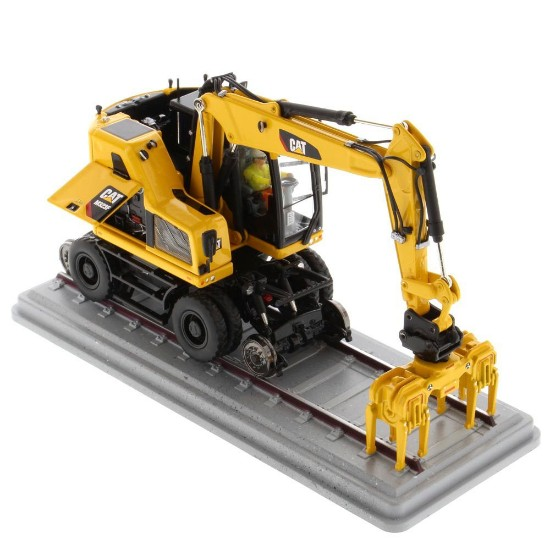Picture of Caterpillar M323F wheel excavator with rail hi-wheels - safety yellow